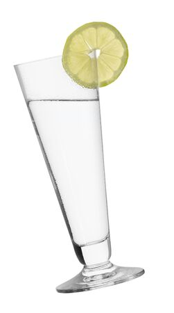 slanted: cocktail glass with sliced lemon piece, filled with clear fluid
