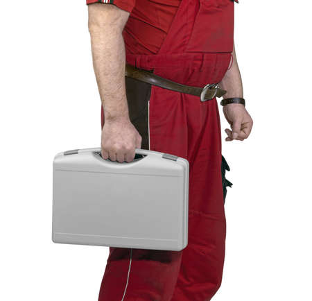 boiler suit: part of a craftsman dressed with red boiler suit holding a grey case