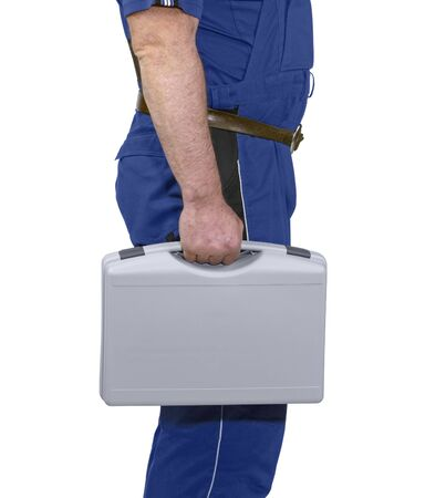 part of a craftsman dressed with blue boiler suit holding a grey case Stock Photo - 12406905