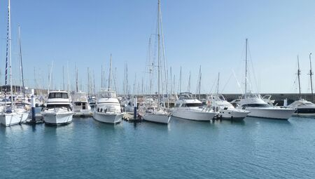 anchoring: a harbour with anchoring ships at Lanzarote  Canary Islands, Spain  Editorial