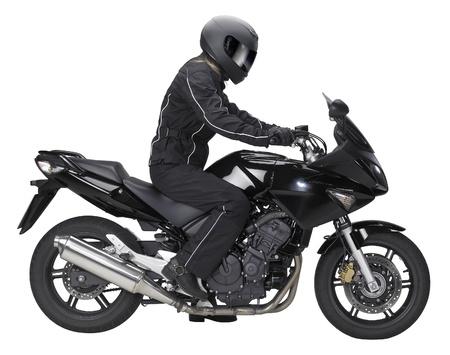 motociclista: lateralmente colpo di una moto con motociclista guida in parte posteriore di bianco