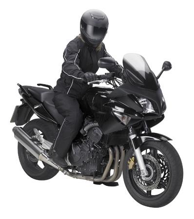 een motorfiets met een biker in het wit terug Stockfoto