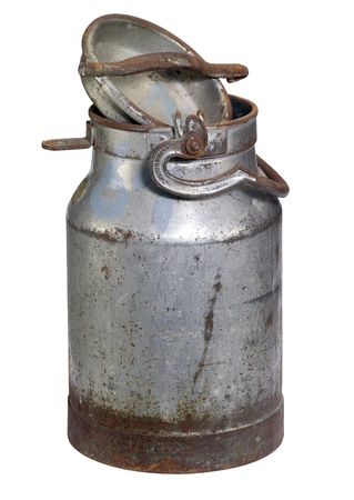 old nostalgic and corroded milk can with cap in white back Stock Photo