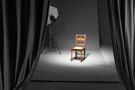 illuminated nostalgic wooden chair in studio ambiance photo