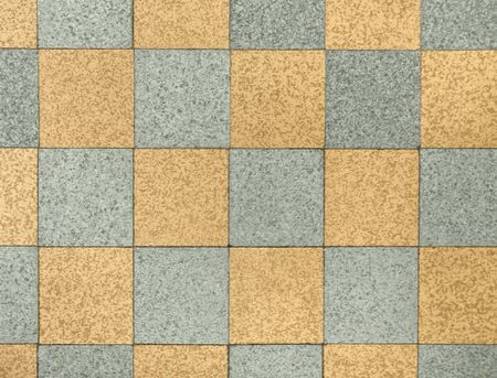 bicolored old stone pattern made of floor tiles photo