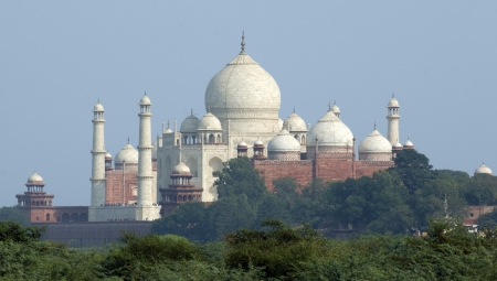 mausoleum named Taj Mahal in Agra, India at evening time photo