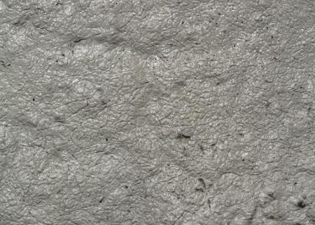 squashy: full frame wet grey muddy background