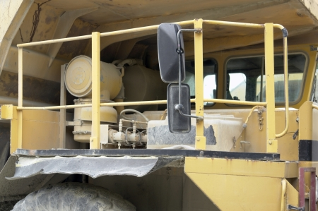 cabin of a yellow rundown dump truck photo