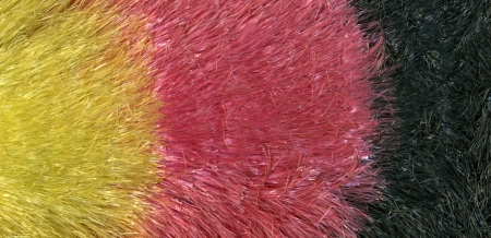 interleaved: abstract background of colorful interleaved translucent plastic fibers