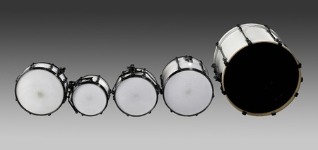 set of white drums in grey gradient back photo