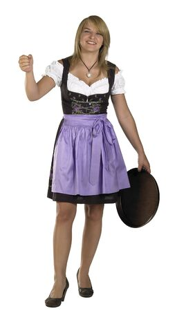 tracht: blond woman with salver wearing a traditional dress named dirndl