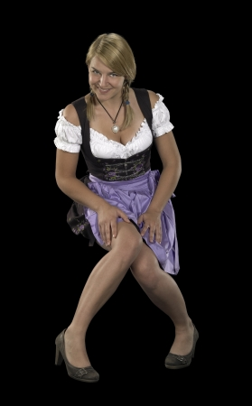 named: flirtatious blond woman wearing a traditional dress named dirndl in black back