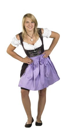 coquettish: coquettish blond woman wearing a traditional dress named dirndl in white back