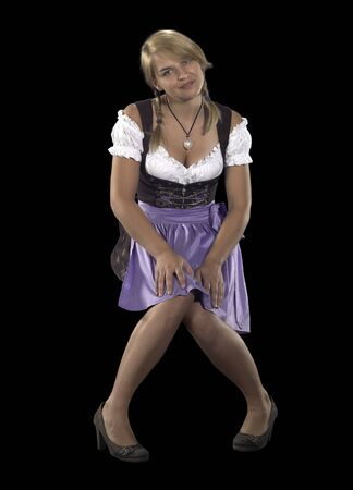 accouterment: shy blond woman wearing a traditional dress named dirndl in black back