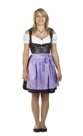 shy blond woman wearing a traditional dress named dirndl photo