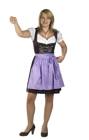 blond woman wearing a traditional dress named dirndl and holding a fictive object  Stock Photo - 15863709