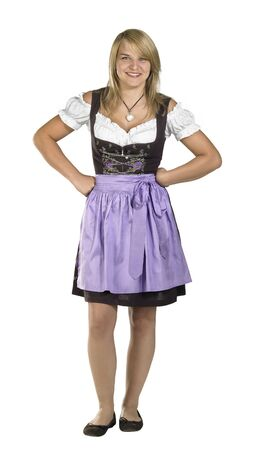 resolute: resolute blond woman wearing a traditional dress named dirndl Stock Photo