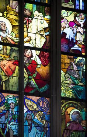 church window: detail of a colorful church window inside the Saint Vitus Cathedral in Prague