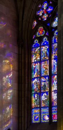 detail of a colorful church window inside the Saint Vitus Cathedral in Prague