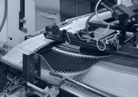 blue toned detail of a folding machine