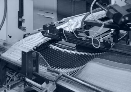 blue toned detail of a folding machine photo