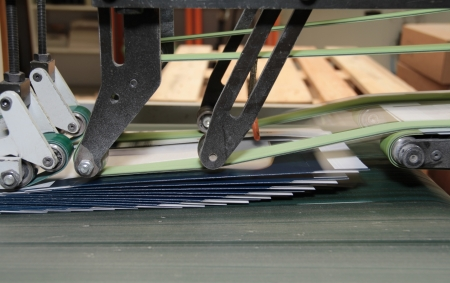 detail of a folding machine with print products