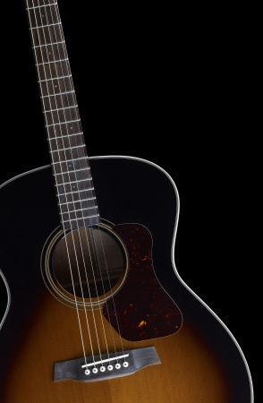 resonating: detail of a acoustic guitar in black back Stock Photo