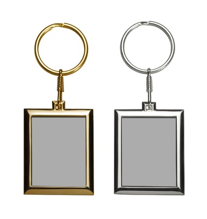 two gold and silver colored keychains with picture frame