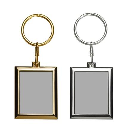 Zwei Gold-und silberfarbene Schlüsselanhänger mit Bilderrahmen Standard-Bild - 17587336