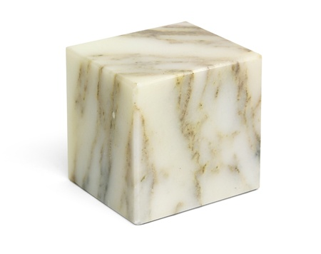 a marble stone cube in white back