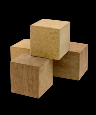 midsagittal: some wooden cubes in black back Stock Photo