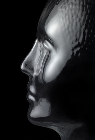 translucent reflective human head made of glass in black back Stock Photo - 18855826