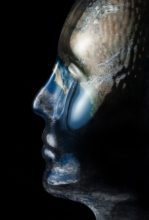 translucent reflective human head made of glass with global surface on it in black back photo