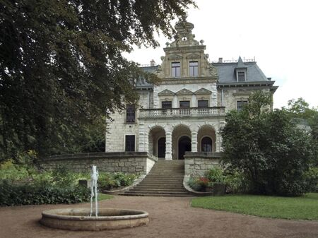 historic building and park with well in Weimar, a city in Thuringia  Germany