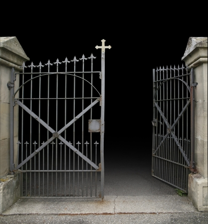 entrance of a graveyard with a open wrought-iron gate in dark gradient back