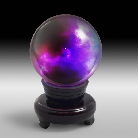 magical equipment: a mystic crystal ball with colorful scenery inside and stand in gradient grey gradient back Stock Photo