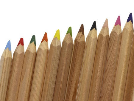 arrangement of wooden colored pencils in white back photo