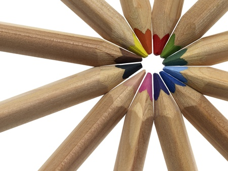 radial arrangement of colored pencils in white back photo