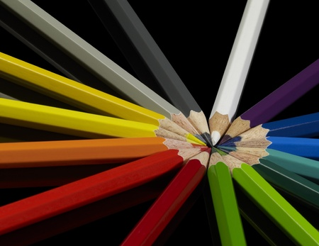 lots of colorful pencils in black back photo