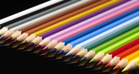 lots of colorful pencils in black reflective back photo