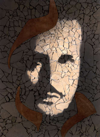 fragmented: picture done by me showing a male face painted on fragmented stone pieces Stock Photo