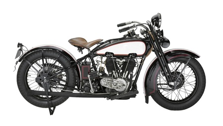 historic motorbike in white back photo