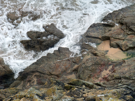 moistness: high angle detail of a rocky coast in Brittany, France