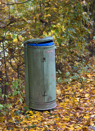 autumn scenery including a trash can photo