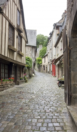dinan: Idyllic street scenery at the port of Dinan, a town in Brittany, France. It is located at the river Rance Stock Photo