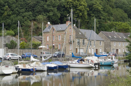 anchoring: Idyllic scenery at the port of Dinan, a town in Brittany, France. It is located at the river Rance
