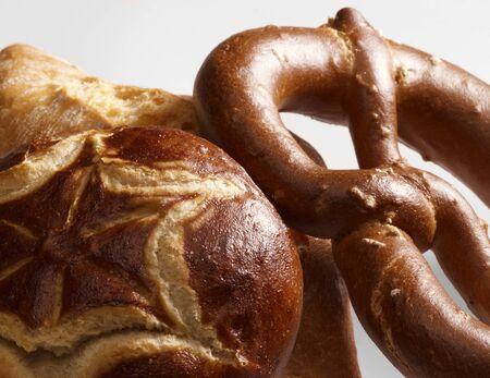 lye: detail of some german lye rolls and bread roll in light back