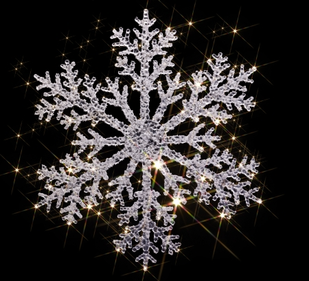 agleam: artificial clear snowflake with lots of twinkling light effects in black back