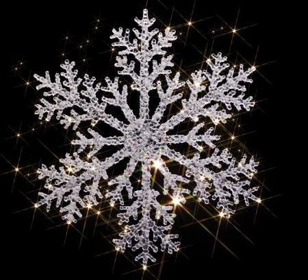 agleam: copo de nieve artificial clara con un mont�n de efectos de luz parpadeantes en la parte posterior negro Foto de archivo
