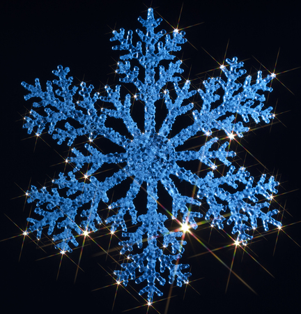 agleam: blue illuminated artificial snowflake with lots of twinkling light effects in black back